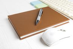 Computer and brown notebook with office supplies Stock Photos