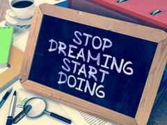 Stock Illustration of Stop Dreaming Start Doing. Motivational Quote on Chalkboard