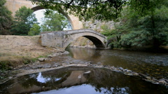 Old stone bridge over river La Cure in the Pierre-Perthuis, Burgundy, France, Eu Stock Footage