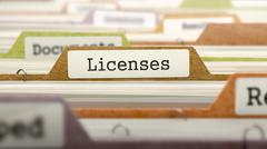 Stock Illustration of Licenses on Business Folder in Catalog