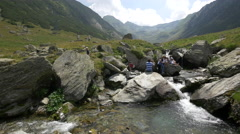 Taking pictures at a small waterfall near Transfagarasan Stock Footage