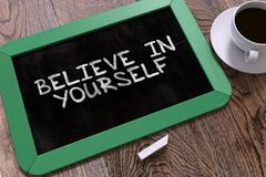 Believe in Yourself - Chalkboard with Hand Drawn Text Stock Illustration