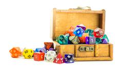 Wooden chest overflows with dice Stock Photos