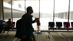 Airport terminal man hold fastfood come against window, POV moving camera - stock footage