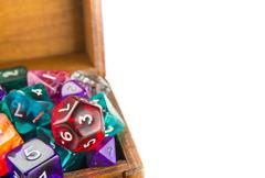 Close up of wooden chest full of dice - stock photo