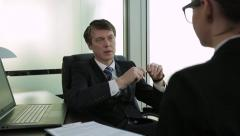Businessman interviewing job applicant Stock Footage