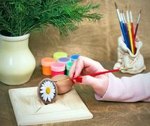 Coloring Easter eggs - stock photo