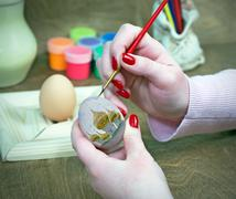 Coloring eggs for Easter - stock photo