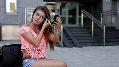 Pretty girl fixing her make-up while waiting for her date. Stock Footage