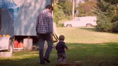 Man and child holding hands and walking away together - stock footage