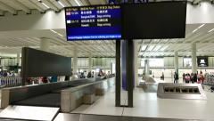Information displays at arrival hall, luggage claim area Stock Footage