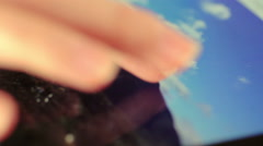 Photos on ipad: finger of a woman browsing pictures; closeup footage Stock Footage