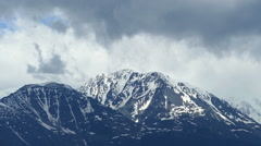 Snow-capped mountain peaks and clouds, timelapse Stock Footage