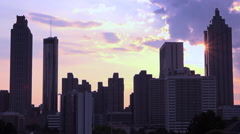 Silhouetted view of skyscrapers and high rises behind Atlanta, Georgia at Stock Footage