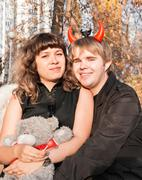 Portrait of angel and devil - stock photo