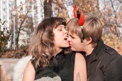 Portrait of angel and devil Stock Photos