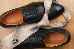 Men's accessories on the wooden floor Stock Photos