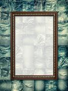 Vintage picture frame on collage jeans - stock photo