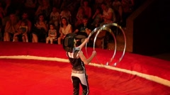 Juggler Carries Out Show With Hoops Stock Footage