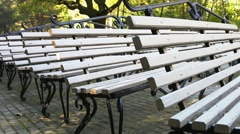 Old wooden benches in the park Stock Footage