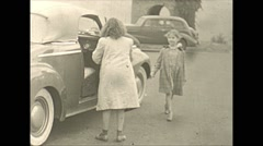 Vintage 16mm film, 1941, girls get in car Stock Footage