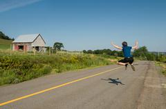 a man jumps on the street - stock photo