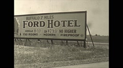 Vintage 16mm film, 1941, signs ford hotel, steamers, shipping Stock Footage