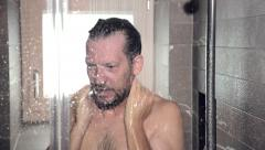 Funny man having a shower Stock Footage