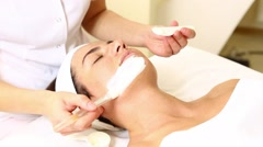 Woman passes treatment mask facial at the beauty salon Stock Footage