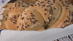 Closeup of kaiser rolls in a basket Stock Footage