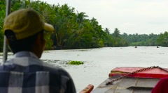 Captain Driving Tourists on sight-seeing boat on The Mekong Delta river Stock Footage