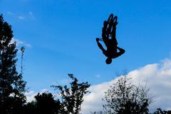 Mountain biker jumps through the air Stock Photos