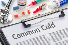 The diagnosis Common Cold written on a clipboard - stock photo
