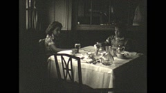 Vintage 16mm film, 1941, girls at dinner table Stock Footage