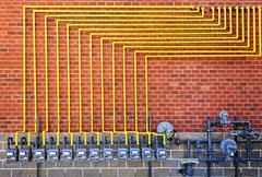 Stock Photo of Gas meters on brick wall