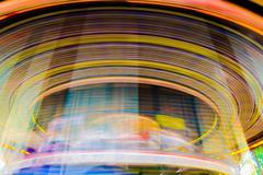 Motion of vintage merry-go-round carousel. Stock Photos
