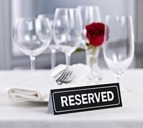 Reserved table at romantic restaurant Stock Photos