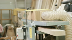 4K Professional carpenter in his workshop, cutting timber on industrial machine - stock footage