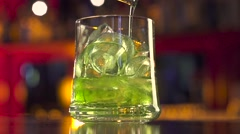 Barman pouring coctail on black table with reflection Stock Footage
