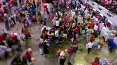 Mess crowd at check-in counters, airport flight register area, timelapse Stock Footage