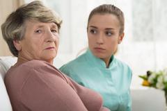 Depressed senior woman - stock photo