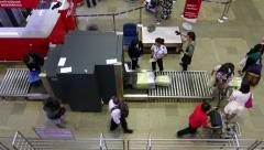 Passenger luggage scanned at X-ray, people entering airside terminal area Stock Footage