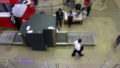 Man walk beside X-Ray scanner airport hall, view from above, no luggage Stock Footage