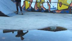 Urban grafitti reflection on water skateboarder - stock footage