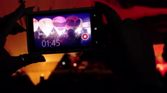 Taking video with smartphone during 2015 Bristol Balloon Fiesta - night show Stock Footage