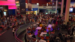 Huge crowds mill about in the interior of the Georgia Aquarium in Atlanta. Stock Footage
