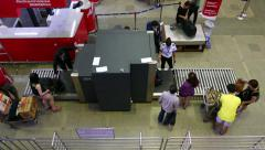 X-Ray security scanner at airport, check passenger baggage, timelapse Stock Footage