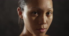 Young sports woman's face sweating from exercise Stock Footage