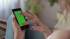 Woman hands touching, scrolling, zoom in, zoom out smartphone.green screen Stock Footage