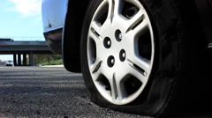 Flat Tire on Side of Freeway Stock Footage